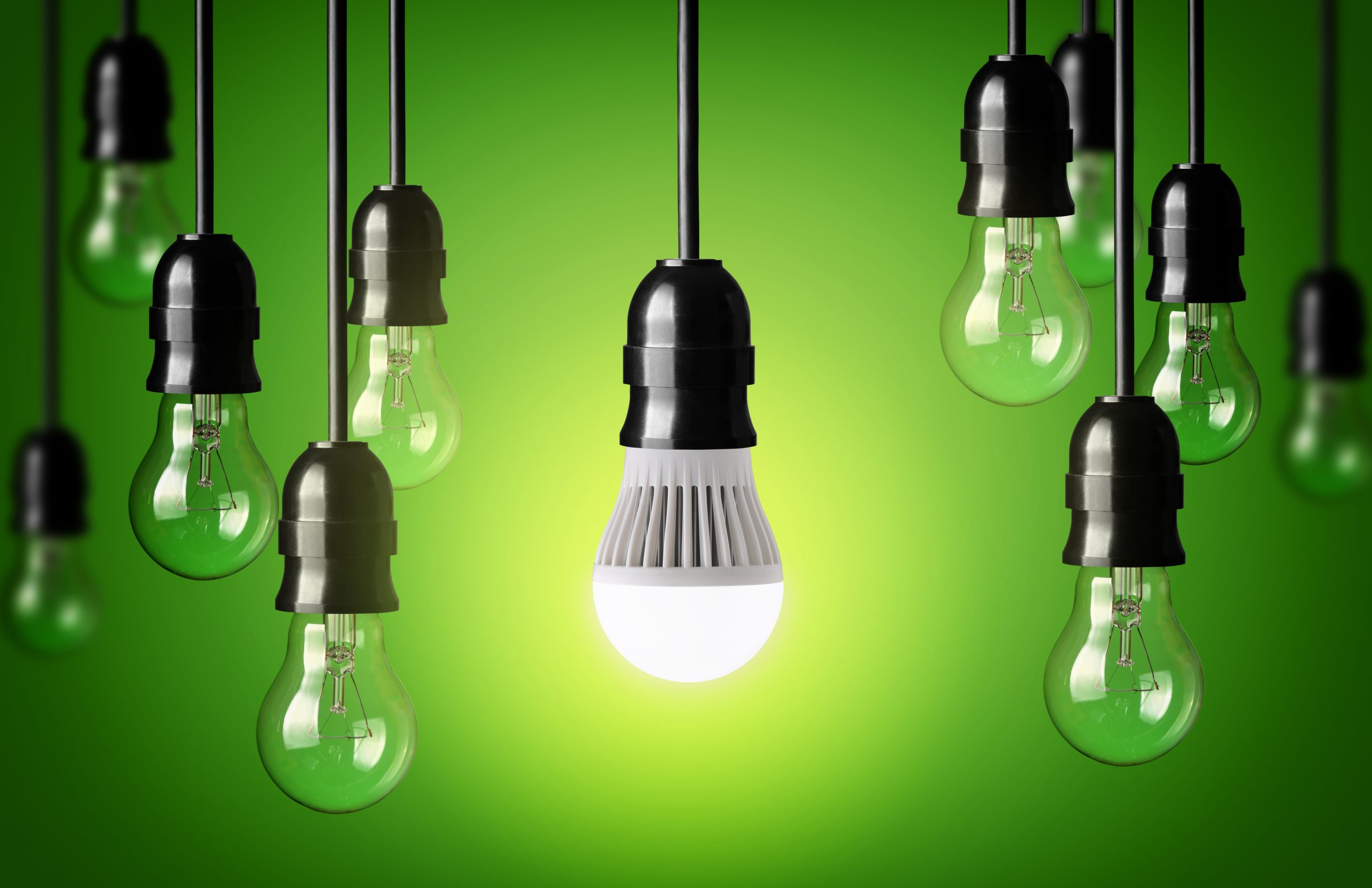 eleven lightbulbs, the only one that's on is the one in the middle, it also has a dark green to light green background - LasVegasRealEstate.com